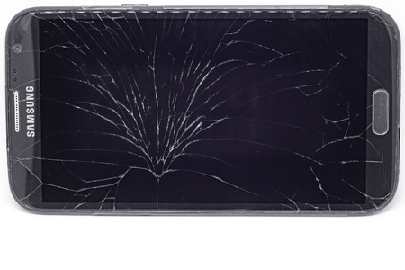 VILNIUS, LITHUANIA - NOVEMBER 2017 - top-view of Cracked Touch Screen Phone, background, texture Stock Photo