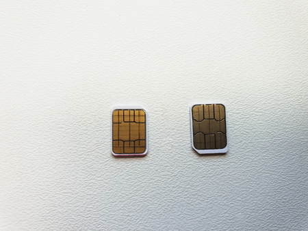 two micro sim cards on a light background surface67