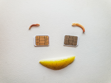 Two micro sim cards lying in the shape of a smiling face