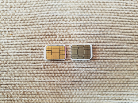two micro sim cards on a wooden surface background