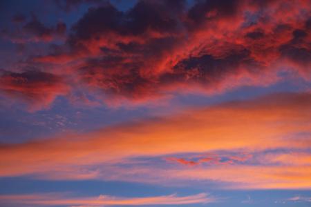 dramatic sky with orange clouds at sunset Фото со стока