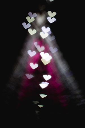 The bokeh of heart shape from the beautiful christmas pink and w