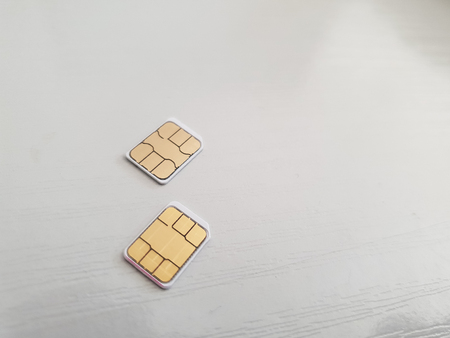 two micro sim cards on a light background surface