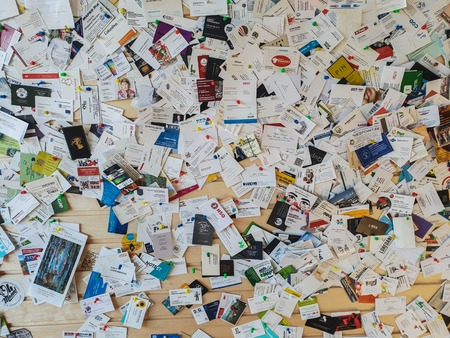 TALLINN, ESTONIA - MAY 2018 - A large number of business cards a Фото со стока