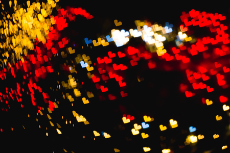 The bokeh of heart shape from the beautiful colourful light decoration at night
