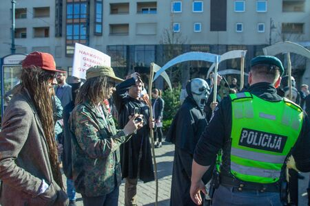Vilnius, Lithuania - May 19 , 2018: police officer at the protest action of the legalization of marijuana
