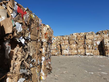 Stack of paper and cardboard garbage at recycling plan Фото со стока