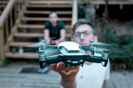 Vilnius, Lithuania - June 8, 2019: Man holding DJI MAVIC AIR - drone with camera, mounted on a 3-axis gimbal.