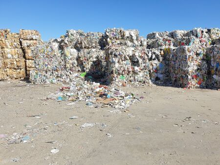 Stack of paper and cardboard garbage at recycling plan Standard-Bild
