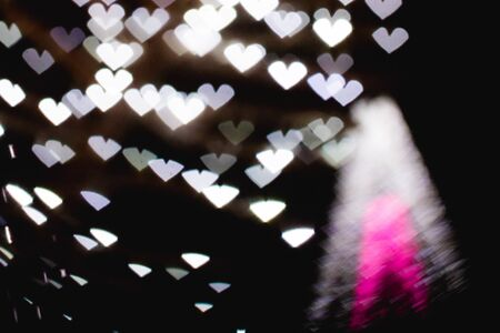 The bokeh of heart shape from the beautiful colourful light decorations at night