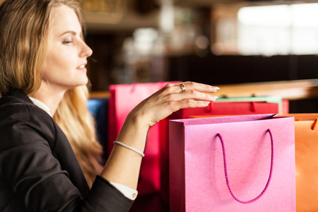 Lovely blond woman preparing presents for christmas and new year for her family