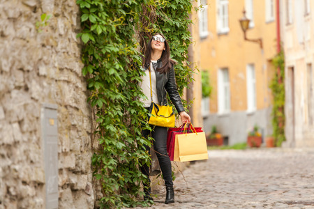 Fashion model made shopping and buying dress in bags Stock Photo