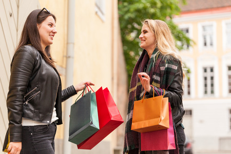 Old friends meet in the od town after black friday sale Stock Photo