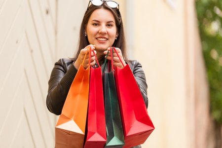 Riant caucasian woman carrying fashion store bags Stock Photo