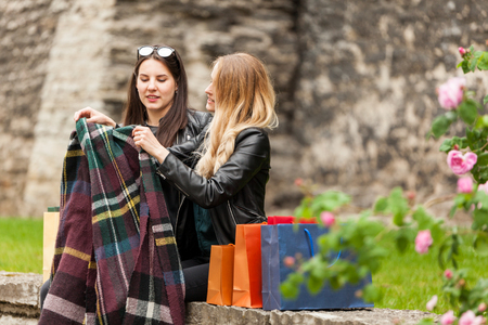 Two cute girls cover with a blanket in a cold day Stock Photo