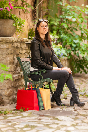 Young woman sits on a bench