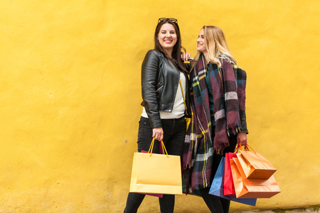Close girlfriends spend time together at shopping trip
