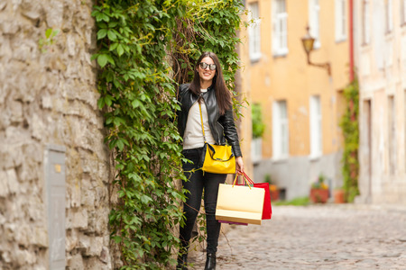 Woman enjoys walking on a beautiful Italian fashion street