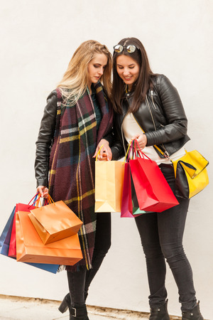Girls are watching their purchases in a bags