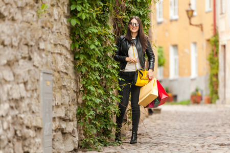 Cool student shows off in a leather jacket and glasses with many gifts from followers