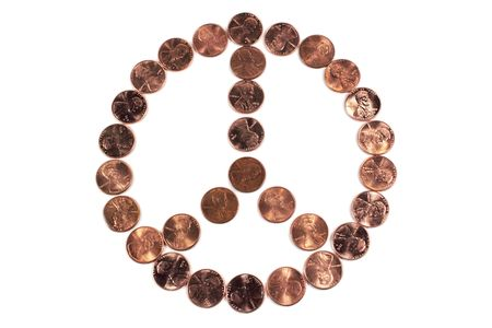 pennies: Peace symbol arranged from pennies on white background.