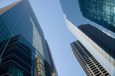 Corporate office towers reach into sky in north american city.