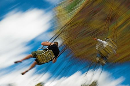 calgary stampede: Swings at major midway with blurr of motion. Stock Photo