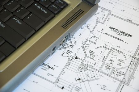 Laptop computer and residential blueprints. Stock Photo - 848123