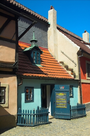 housed: The houses of the Golden Lane are located along the inside of the walls of Prague Castle, and housed palace guards.