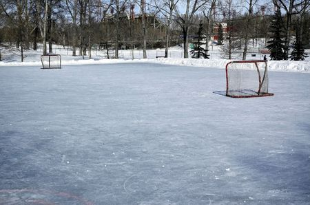 Outdoor skating rink covered ready for the game to start. Stock Photo