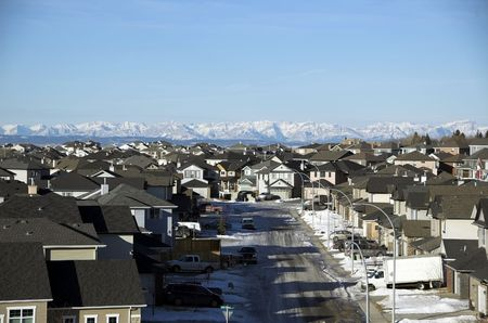 suburbs: Sunrise in Calgary suburbs looking towards the rocky mountains. Stock Photo