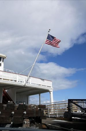 American flag mounted on the front of a ferry boat. Stock Photo - 2613483