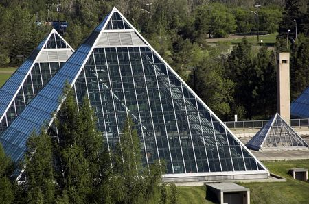 conservatory: Summer view of a modern building (muttart conservatory) and its reflections, Edmonton, Alberta, Canada