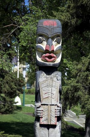 West coast totem pole donated to Alberta Government and sits on legislative grounds.  photo