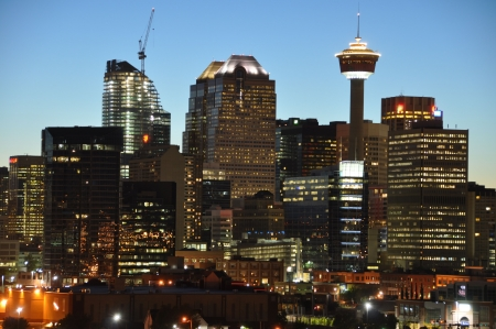 elite: Calgary skyline shimmers as the sun sets on the centre of the city.