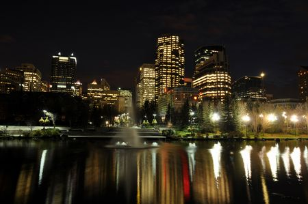 Skyscrapers tower over urban park space in Calgary along the famous Bow River photo