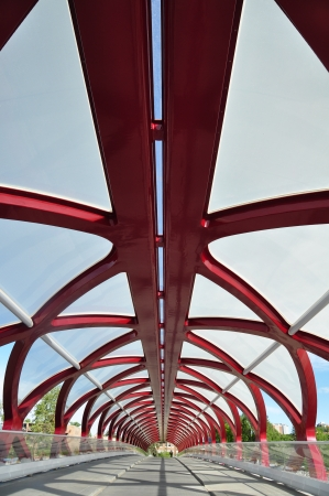 coulorful: Calgary, Canada -June 7, 2012  Inside Calgary s Peace Bridge which spans the Bow River between downtown and Sunnyside neighbourhood  The helix shaped metal bridge makes for interesting patterns