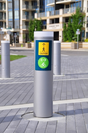cautionary: Cautionary signage for pedestrian and bicycle path crossings in Calgary Alberta  Stock Photo
