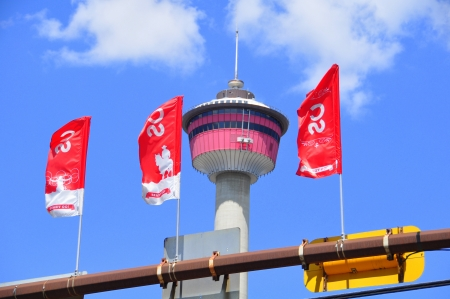 Calgary Stampede Banners with the Calgary tower in the background  It is the 100th aniversary of the Stampede, also known as the Greatest Outdoor Show on Earth
