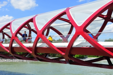 coulorful: Inside Calgary s Peace Bridge which spans the Bow River between downtown and Sunnyside neighbourhood  The helix shaped metal bridge makes for interesting patterns