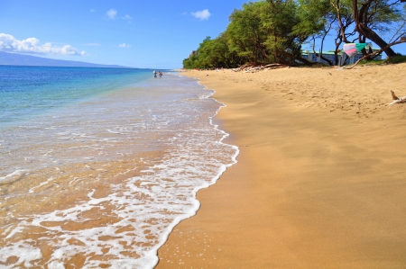 Beautiful ocean beach along west Maui s famous Kaanapali beach  Molokai is visible in the distance  photo