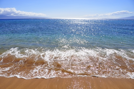 Beautiful ocean beach along west Maui s famous Kaanapali beach  Molokai is visible in the distance Stock Photo - 14535130
