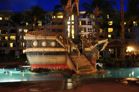 View of the entrance to the kids pool at night at a luxury hotel and time share condominium resort, Kaanapali, Maui, Hawaii with palm trees