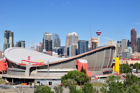 calgary: Calgary Saddledome on August 1, 2012 in Calgary, Alberta with the Calgary skyline in the background  Saddledome is the iconic home of the Calgary Flames of the NHL   Editorial