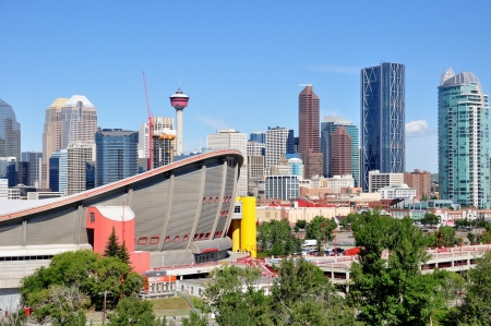 Calgary Saddledome on August 1, 2012 in Calgary, Alberta with the Calgary skyline in the background  Saddledome is the iconic home of the Calgary Flames of the NHL   Editorial