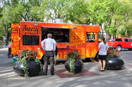 Calgary, Canada - September 18, 2012: Cheezy Business food truck on September 18, 2012 in Calgary, Alberta selling  Editorial