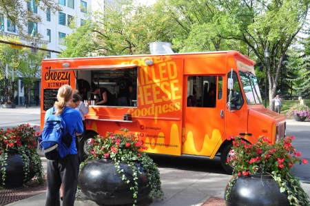 Calgary, Canada - September 18, 2012: Cheezy Business food truck on September 18, 2012 in Calgary, Alberta selling