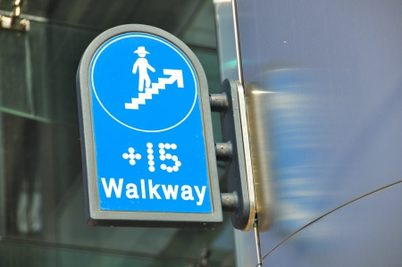 passages: A  plus 15 sign in Calgary Alberta  The Plus 15 network links office buildings in downtown calgary with a series of overhead pedestrian passages  It is the largest such network in the world  Editorial