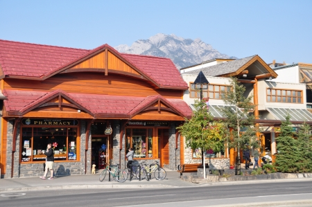BANFF, ALBERTA - September 24: Banff Avenue on September 24, 2012 in Banff National Park, Alberta, Canada. Banff Avenue is the central shopping district in the town of Banff