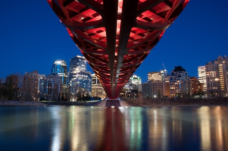 Calgary skyline and a pedestrian bridge in Calgary, Alberta Canada  The pedestrian bridge spans the Bow River photo